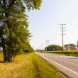 Stock Photo: Scenic countryside empty road with blue sky