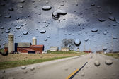 Country Road in the rain — Stock Photo