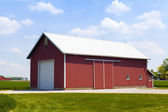 Red Barn With White Garage Door — Stock Photo