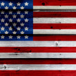 Old Painted American Flag on Dark Wooden Fence — Stock Photo #27089439
