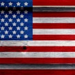 Old Painted American Flag on Dark Wooden Fence — Stock Photo #27089467