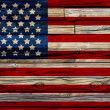 Old Painted American Flag on Dark Wooden Fence — Stock Photo #29186459