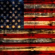 Old Painted American Flag on Dark Wooden Fence — Stock Photo #29186513