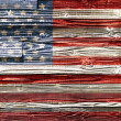 Old Painted American Flag on Dark Wooden Fence — Stock Photo #29186545
