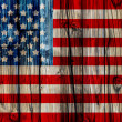 Old Painted American Flag on Dark Wooden Fence — Stock Photo #29186577