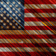 Stock Photo: Old Painted American Flag on Dark Wooden Fence