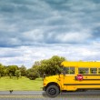School Bus on american country road in the morning — Stock Photo