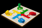 Parchis, tipical spanish game, isolated on black — Stock Photo