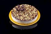 Praline cake, isolated on black — Stock Photo
