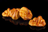 Homemade croissants, isolated on black — Stock Photo