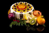 Fruit and cream cake, isolated on black — Stock Photo