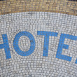 Hotel written in mosaic in front of the entrance - Paris, France. — Stock Photo
