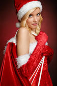 Beautiful girl with Santa Claus gift sack — Foto de Stock