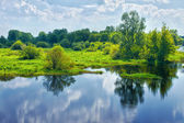 Spring landscape with river and clouds on the sky — Stock Photo