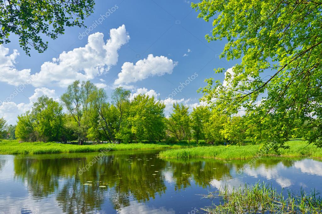 Фотообои Spring landscape with Narew river and clouds on the blue sky