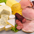 Stock Photo: Ararangement with cheese, ham and sausage on table
