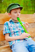 Young boy playing recorder — Stock Photo