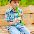 Stock Photo: Young kid playing recorder