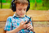 Young boy listening to music — Stock Photo
