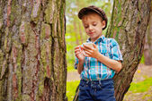 Young kid browsing mobile internet — Stock Photo