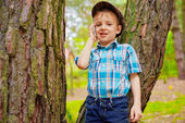 Young kid talking on mobile phone — Stock Photo