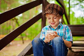 Young stylish boy browsing internet on mobile phone — Stock Photo