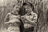 Young stylish boys browse the internet on mobile phone. — Stock Photo