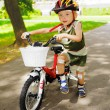Young kid with injured knees is learning to ride bike — Stock Photo #27216791
