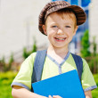 Young boy in front of school — Stock Photo