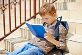 Young boy is reading book — Stock Photo