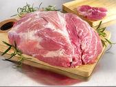 Raw pork ham on cutting board — Stock Photo