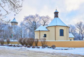 Old chapel and the bishop's castle. Winter landscape. — Stock Photo