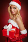 Beautiful sexy santa claus girl with gift box — Stock Photo