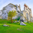 Stock Photo: Ruins of Old Medieval Castle on Rocks. Surrealistic landscape