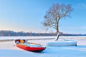 Boats on the frozen river. — Stock Photo