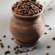 Old grungy pot full of roasted coffee beans. — Stock Photo #40754847