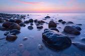 Beautiful stones in the ocean. The Baltic Sea coast, Poland. — Stock Photo