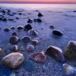 Sunset ocean stones. Baltic Sea coast, Poland. — Stock Photo #48847889