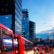 Street traffic by night in London - Stock Photo