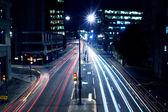 Cars lights on London street by night — Stock Photo