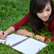Pretty women writing book — Stockfoto