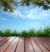 Wooden terrace and blue sky — Stock Photo