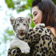 Women hold baby white bengal tiger — Stock Photo