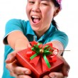 Woman smile and hold gift box in hands — Zdjęcie stockowe