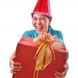 Woman smile and hold gift box in hands — Stock Photo