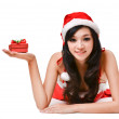Santa woman  holding a gift box — Stock Photo