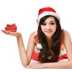 mulher Santa segurando uma caixa de presente — Foto Stock