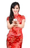 Pretty women with Chinese traditional dress Cheongsam and drinki — Stock Photo