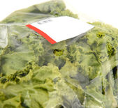 Iceberg lettuce in plastic bag package — Stock Photo