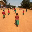 African Children go to church in the village Pomerini of the Fr — Stock Photo #12266597